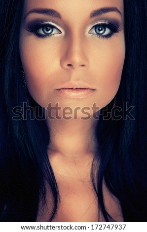 portrair attractive girl with blue eyes and dark lashes