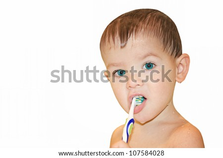Portrait a child cleans teeth a tooth brush on a white background - stock photo