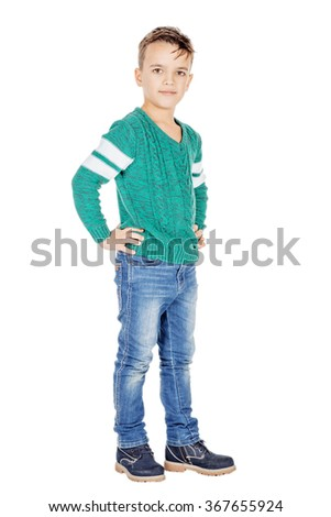 Portrait adorable full body boy on white studio background.