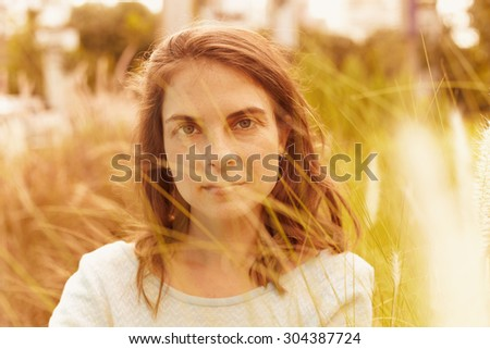 Portrait adult woman at the outdoor in field - stock photo