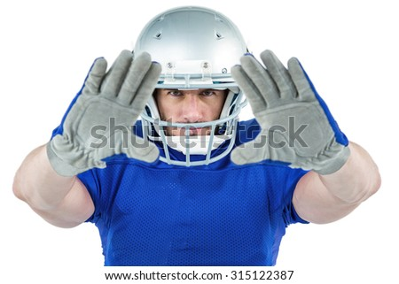 Portrait American football player defending against white background