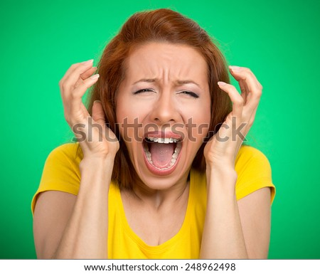 portrait angry woman screaming wide open mouth hysterical isolated green background. Negative human face expression emotion bad feeling reaction. Conflict confrontation concept. Too many things to do - stock photo