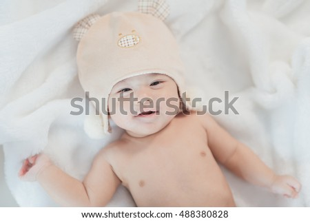 portrait asia baby on white bed