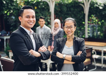 portrait asian business team at a cafe while having a break - stock photo