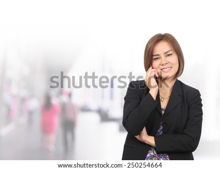 portrait asian businesswoman 30 - 40 year old with use phone has shopping mall background. Mixed Asian / Caucasian businesswoman.  - stock photo