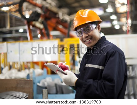 Portrait asian engineer smiling  look on you camera - stock photo