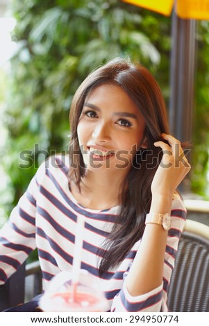 Portrait asian model in outdoore cafe for drinking - stock photo