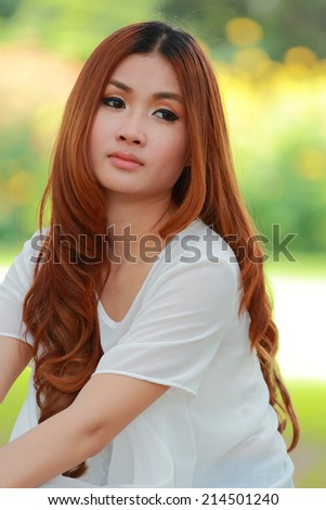 portrait asian women in white shirt,close up