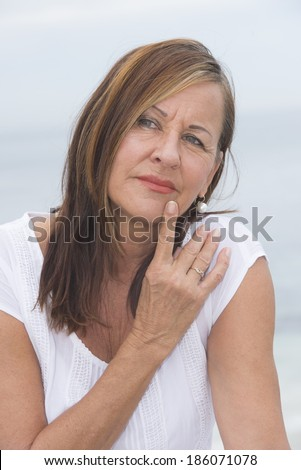 Portrait attractive mature woman looking concerned and worried, thoughtful with finger on cheek. - stock photo