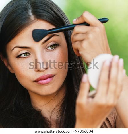 portrait attractive naked dark-haired women sex looks mirror powder background summer park - stock photo