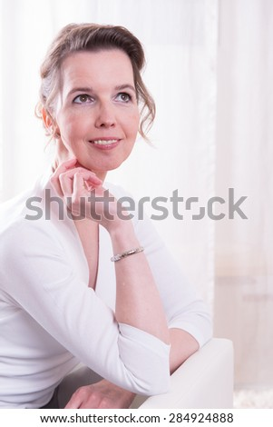 Portrait attractive woman with head on hand - stock photo
