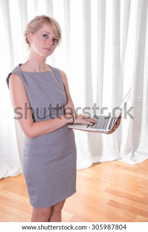 Portrait attractive young business woman with laptop