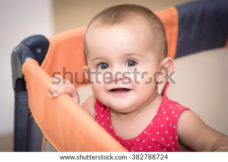 Portrait baby on the bed in her room - stock photo