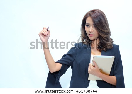 Portrait beautiful asian woman standing, Hold tablet ,showing blank area for sign or copyspace On the white background