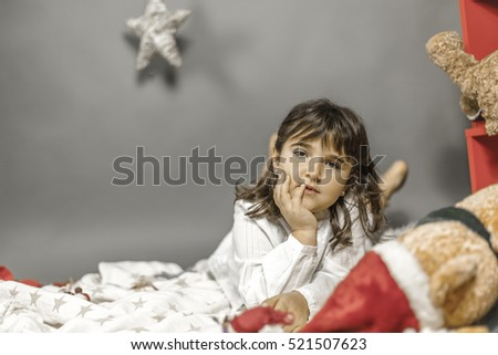 Portrait beautiful dreamer girl in Christmas time. At home with ornaments