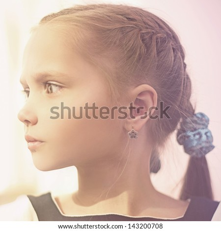 portrait beautiful girl, schoolgirl in the room - stock photo