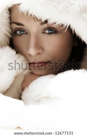 Portrait beautiful girl wearing white fur - stock photo