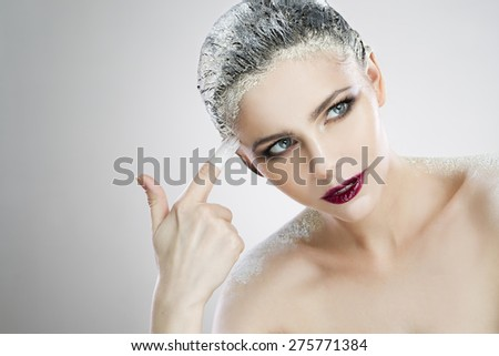 Portrait beautiful girl with creative make-up close-up. Spa. Skin care and hair care. Hair mask of clay - stock photo