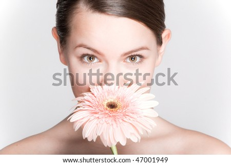 Portrait Beautiful girl with flower. Focus on eyes - stock photo