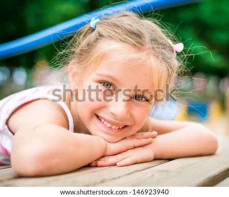 portrait beautiful smiling little girl on a playground - stock photo