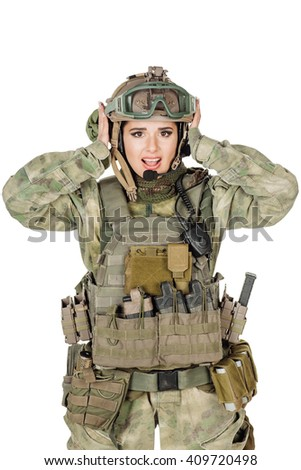 Portrait beautiful soldier or private military contractor ?losing ears with hands. war, army, weapon, technology and people concept. Image on a white background. - stock photo