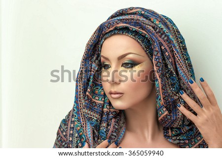 Portrait beautiful woman, arabic makeup, colorful turban