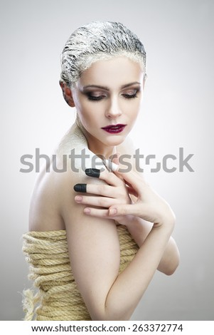 Portrait beautiful woman with creative makeup. Spa. Skin care and hair care. Hair mask of clay