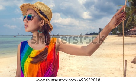 portrait beautiful women wear sunglass and hat colourful in dress colourful on sun light day in beach hat having summer fun during travel holidays vacation