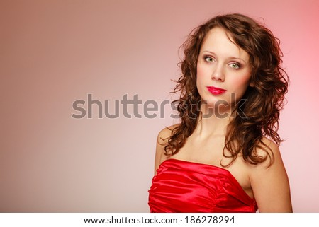 Portrait beautiful young fashion woman smiling teen girl in red dress on pink background