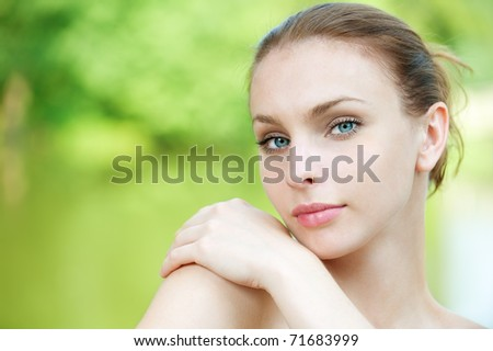 portrait beautiful young woman on green background