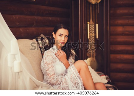 portrait beautiful young woman wearing lace dress, relaxing and smiling in bright room, on the couch.