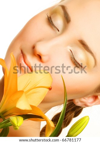 portrait beauty woman face with yellow lily flower - stock photo