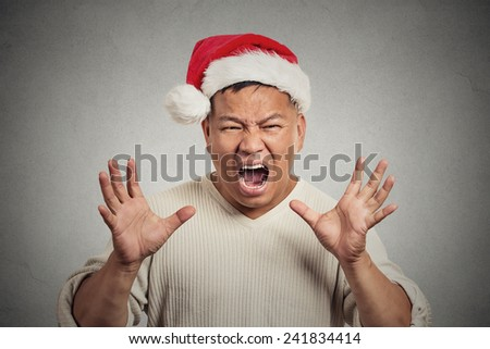 Portrait, bitter, displeased angry, grumpy man yelling screaming isolated grey wall background. Negative human emotion facial expression