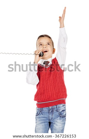 Portrait Boy emotionally  talking on the wired telephone on white background.