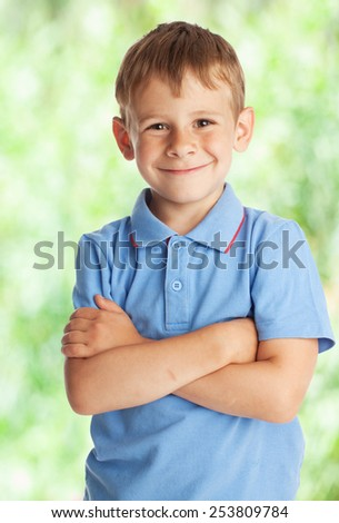 Portrait boy outdoors. Happy child in summer - stock photo