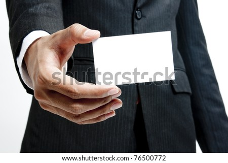 Portrait business man holding blank note card