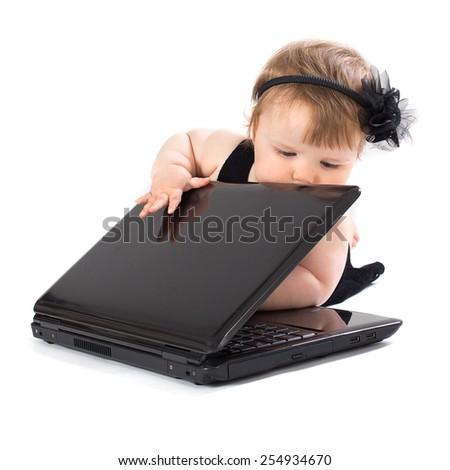 Portrait child with black laptop on white - stock photo