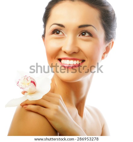 portrait close up of Beautiful woman face with orchid flower, model is a asian beauty. - stock photo