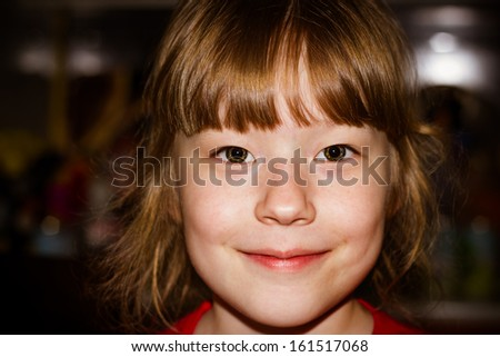 Portrait close-up of the lovely little girl - stock photo