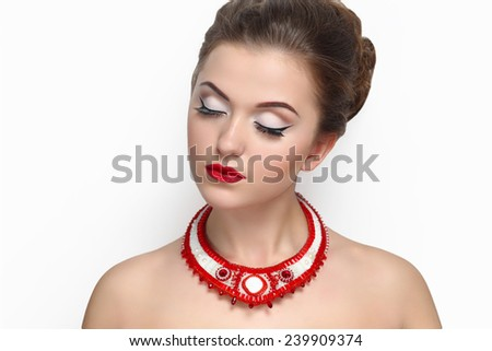 Portrait close-up of very beautiful perfect woman with bright make up, red velvet lipstick, necked shoulders, pretty face stylish hair do, necklace. Clean white wall photo studio background isolated.  - stock photo