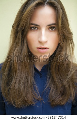 Portrait close up of young beautiful brunette woman in black dress, indoor