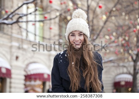 Portrait close up of young beautiful woman, on winter park  nature background - stock photo