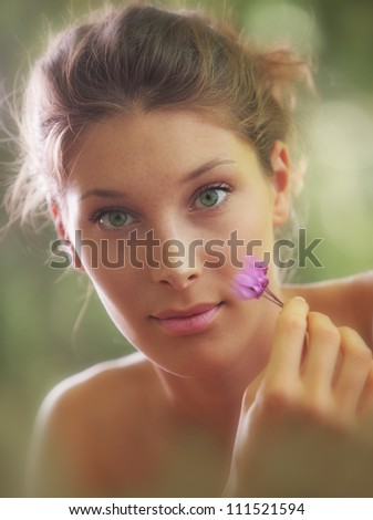 Portrait close up of young beautiful woman with flowers - stock photo