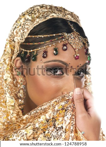Portrait close-up shot of a attractive young female in wedding costume and obscuring face with veil. - stock photo