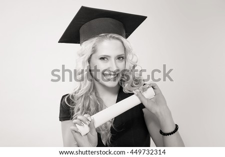 Portrait closeup black and white beautiful smile happy ecstatic graduate graduated student girl young woman in cap gown celebrating being a winner holding diploma scroll. Celebrating graduation - stock photo