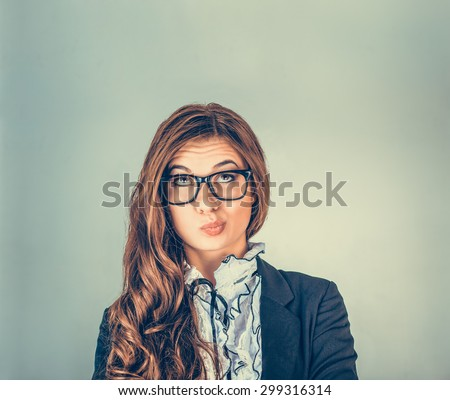 Portrait closeup funny confused skeptical woman girl female thinking with glasses looking up isolated green wall background copy space above head. Human expressions, emotions, feelings, body language - stock photo