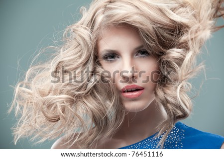 portrait curly blonde looking blue dress - stock photo