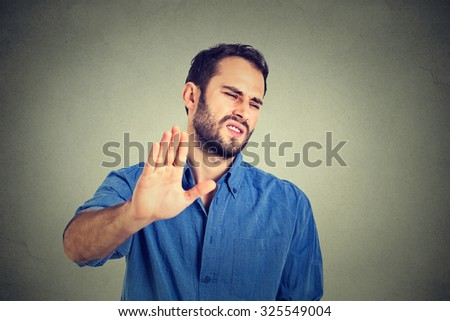 Portrait disgusted young man. Negative human emotion - stock photo