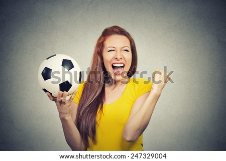 Portrait excited woman screaming celebrating team success holding football  - stock photo