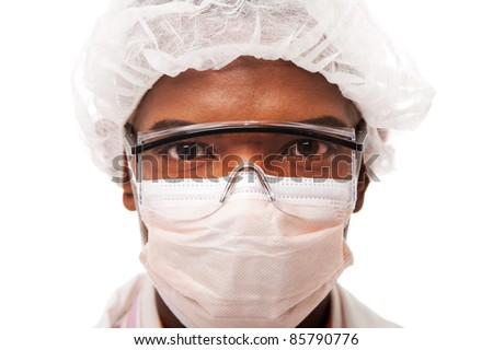 Portrait face of a handsome man dressed as doctor physician scientist surgeon or working in the food industry, with mouth and hair cap for hygiene, isolated.